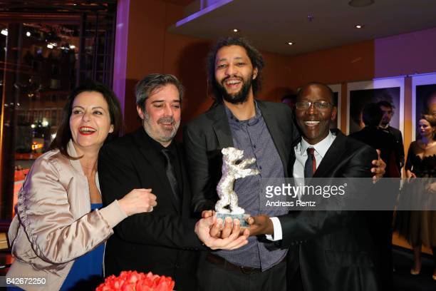 Film producer Arnaud Dommerc film director Alain Gomis and producer Oumar Sall holding the Silver Bear Grand Jury Prize for their film Felicite at...
