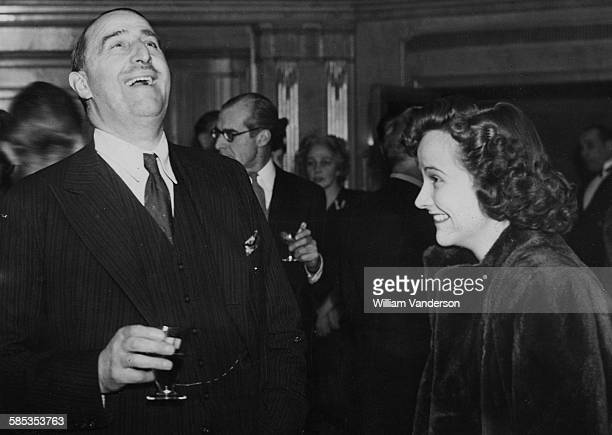 Film producer Arthur J Rank sharing a joke with actress Kim Hunter while attending a party at the Dorchester Hotel London December 7th 1945