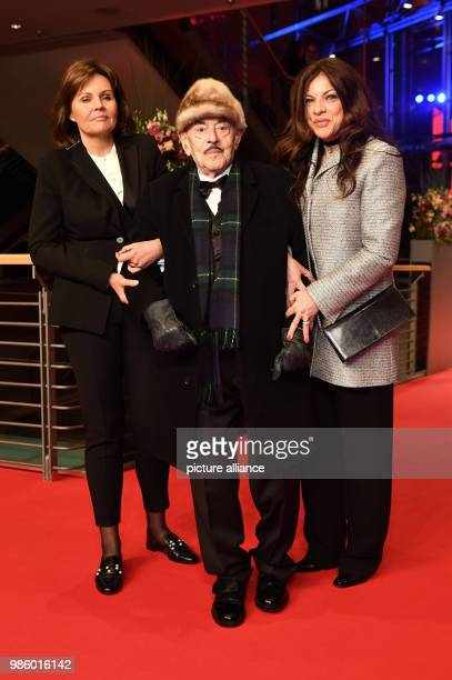 Film producer Artur Brauner his daughter Alice Brauner and company 'Bettina' attend the opening night of the film 'Isle of Dogs' during the Berlinale...