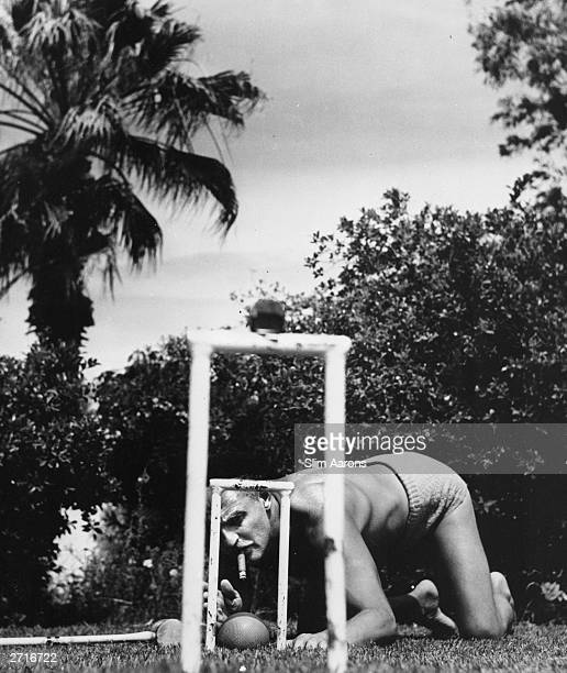Film producer Darryl Zanuck a keen player at Howard Hawks' EastWest croquet match in Beverly Hills Original Publication A Wonderful Time Slim Aarons