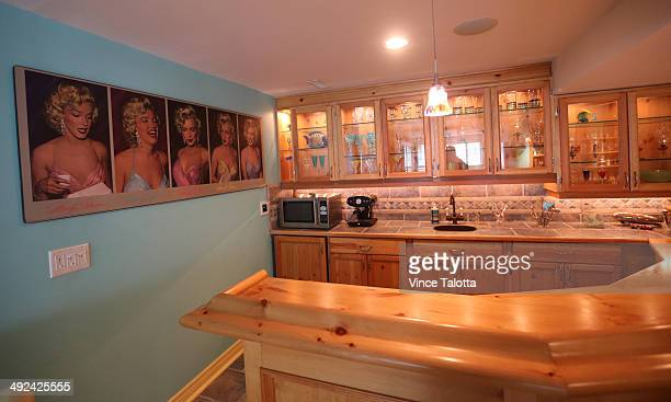 TORONTO ON MAY 15 Film producer Don Carmody and wife Catherine Gourdier basement bar in their Forest Hill home in Toronto on May 15 2014