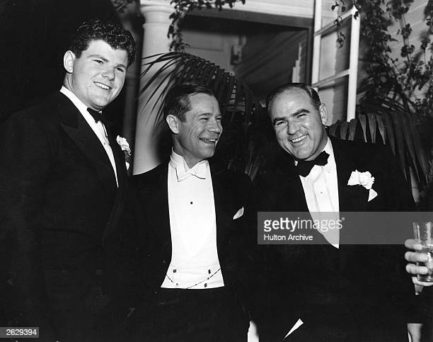 US film producer Hal Roach laughing with friends The man in the middle is comic actor Joe E Brown Original Publication People Disc HK0476