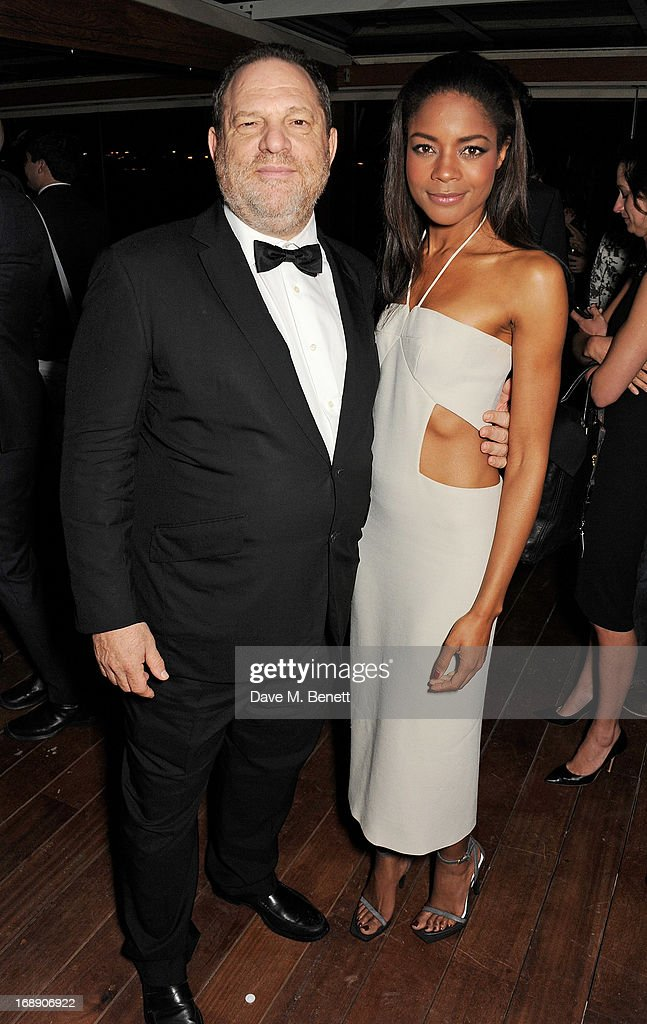 Film producer Harvey Weinstein (L) and actress Naomie Harris attend the IFP, Calvin Klein Collection & Euphoria Calvin Klein celebration of Women In Film At The 66th Cannes Film Festival on May 16, 2013 in Cannes, France.