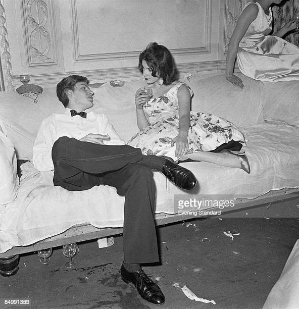Film producer Hercules Bellville and Jenny Birkin at a party at Hamilton Place, London, 1st June 1959.