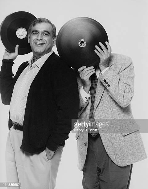 Film producer Ismail Merchant and director James Ivory holding reels of film 1990 They are partners in the MerchantIvory production company