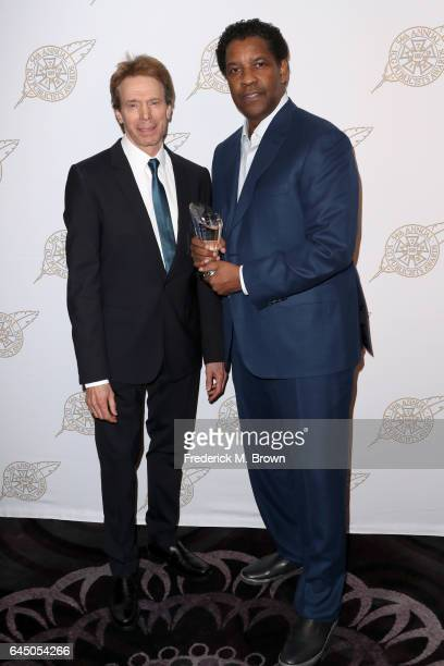 Film Producer Jerry Bruckheimer and Motion Picture Showman of the Year Award Winner Denzel Washington pose backstage at the 54th Annual International...