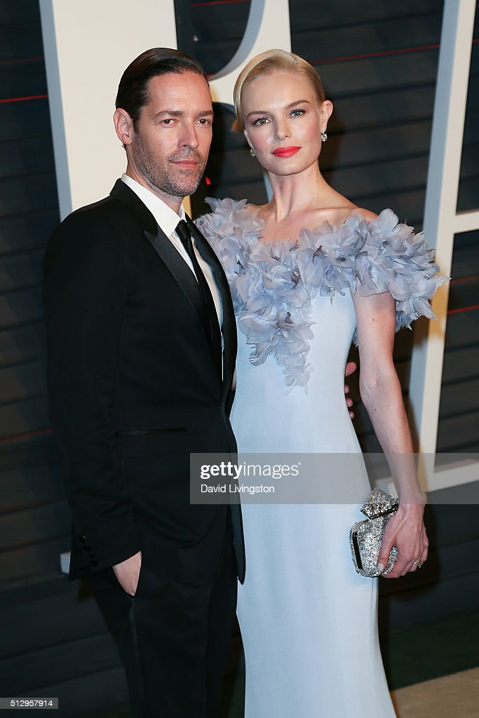 Film producer Michael Polish (L) and actress Kate Bosworth arrive at the 2016 Vanity Fair Oscar Party Hosted by Graydon Carter at the Wallis Annenberg Center for the Performing Arts on February 28, 2016 in Beverly Hills, California.