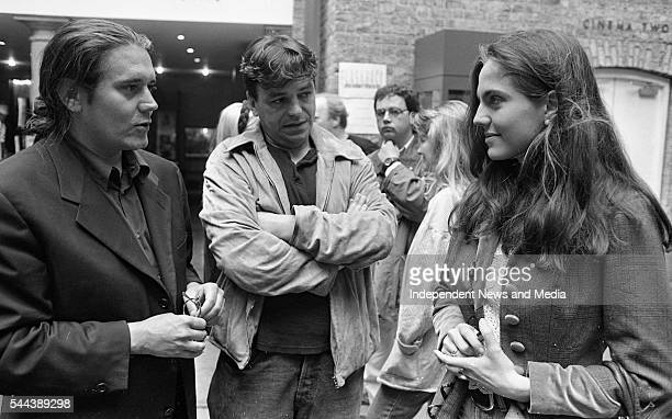 Film producer Steve Woolley and director producer and writer Neil Jordan speak with an unidentified woman at the Gregory Peck Script Writing Summer...