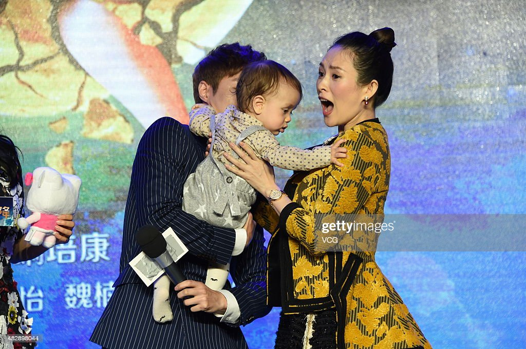 Film producer Zhang Ziyi (R) and the son of director Wei Nai attend the press conference of Wei Nan and Wei Min's film 'The Baby From Universe' on August 4, 2015 in Beijing, China.