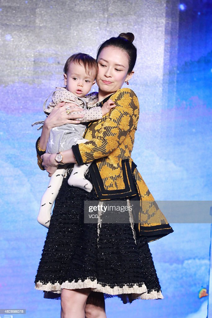 Film producer Zhang Ziyi and the son of director Wei Nan attend the press conference of Wei Nan and Wei Min's film 'The Baby From Universe' on August 4, 2015 in Beijing, China.