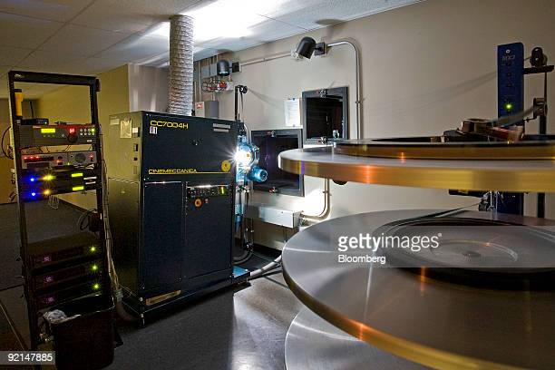A film projector plays a movie at a Harkins movie theater in Denver Colorado US on Friday Oct 16 2009 Theater owners are converting to digital...