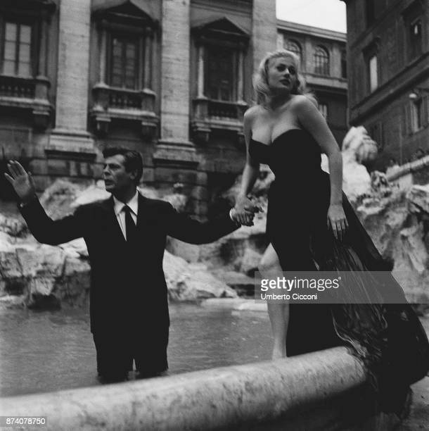 Film set of 'La Dolce Vita' at Trevi Fountain with actor Marcello Mastroianni and actress Anita Ekberg Rome 1959
