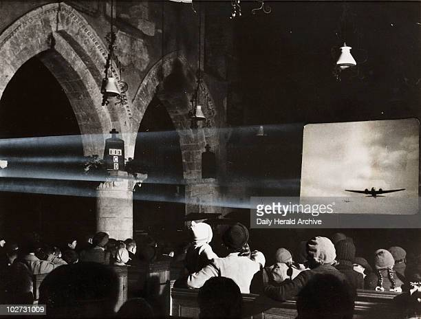 Film show in a church 1941 A photograph of a Ministry of Information film show in St Mary's Church in Charminster Dorset taken by Calcraft for the...