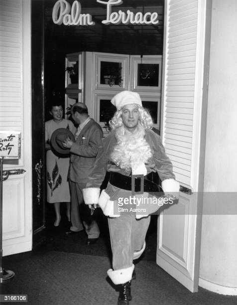 Film star and crooner Bing Crosby in a Santa Claus outfit outside the Beverly Hills Hotel where a Christmas lunch was held in aid of the Women's...