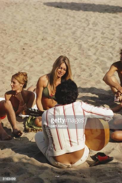 Film star Brigitte Bardot being serenaded on the beach at Costa del Sol