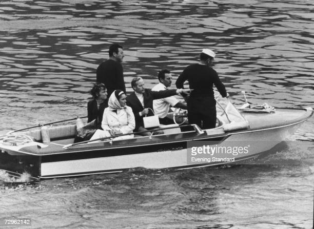Film star Elizabeth Taylor is transported ashore from her luxury yacht Kalizma, moored off Tower Pier in London, July 1968.