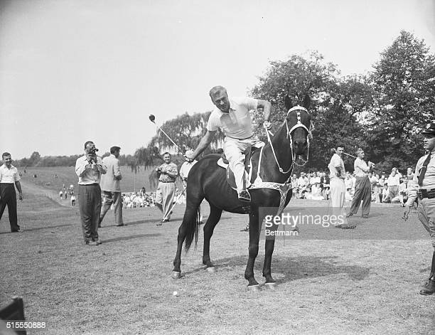 Film star Gary Copper on horseback, tees off on the first hole at the National celebrities golf tourney being held at the Congressional Country Club.