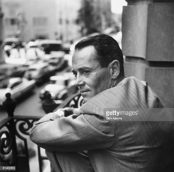 Film star Henry Fonda on a balcony overlooking a street in New York