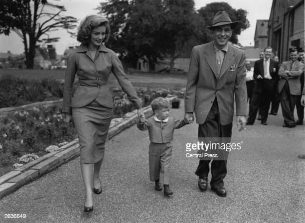 Film star Humphrey De Forest Bogart and his fourth wife Lauren Bacall walk their son Stevie through the grounds of Isleworth film studios where he...