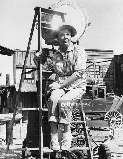 Film star Ida Lupino wearing jeans and sneakers sits on a ladder while directing a Western The Only Man in Town for CBS television's weekly series...