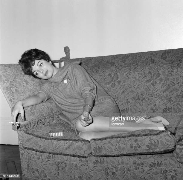 Film star Joan Collins flew into London today pictured at her parents flat in Regent's Park 25th November 1958