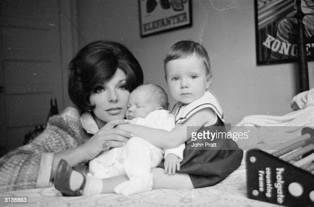 Film star Joan Collins wife of actor and singer Anthony Newley with her daughter Tara aged two and six week old Alexander Sasha for short