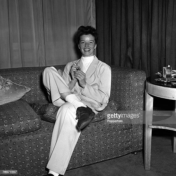 Film star Katherine Hepburn smiling as she sits on a comfortable sofa at a press reception at Claridges London 16th April 1951
