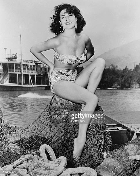 Film star Mara Corday is surrounded by things nautical as she relaxes on a fisherman's pier It's obvious why she's been netting so much attention on...