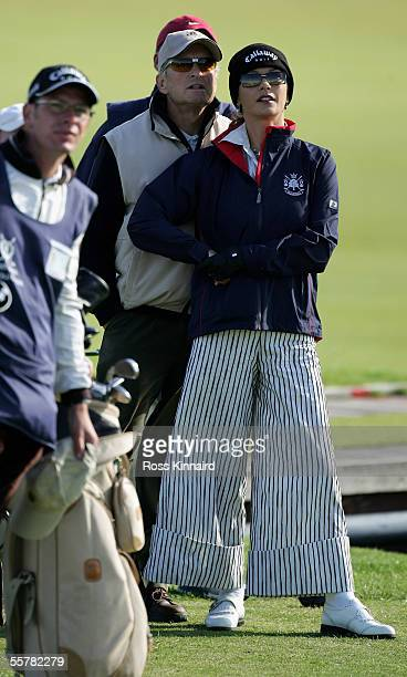 Film Star Michael Douglas and his wife Catherine ZetaJones watch from the 2nd tee during a practice round prior to the Dunhill Links Championships on...