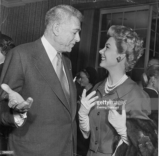 Film star Mitzi Gaynor chatting to lyricist Oscar Hammerstein II She starred in 'South Pacific' he partnered Richard Rodgers and wrote lyrics for...