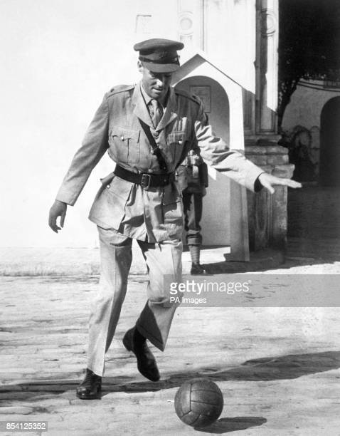 Film star Peter O'Toole enjoys a game of football during a break in filming for Lawrence of Arabia