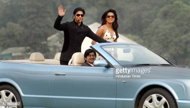 Film star Shahrukh Khan and Priyanka Chopra poses for photographers at the Jaipur polo ground in New Delhi on Sunday