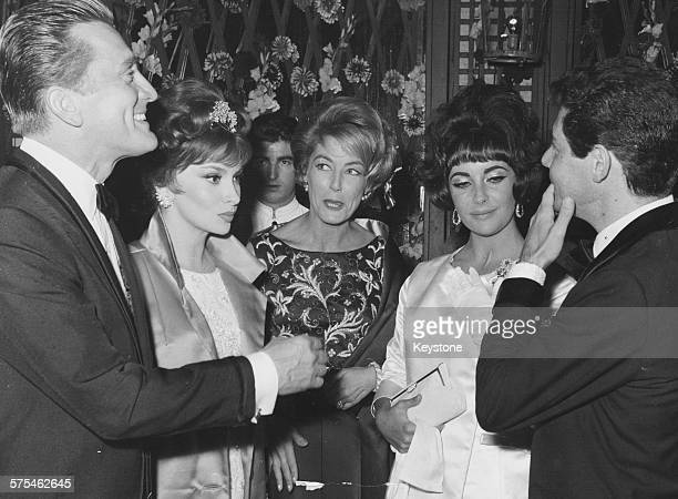 Film stars attending a party held by actress Elizabeth Taylor and singer Eddie Fisher including Kirk Douglas Gina Lollobrigida and Anne Douglas in...