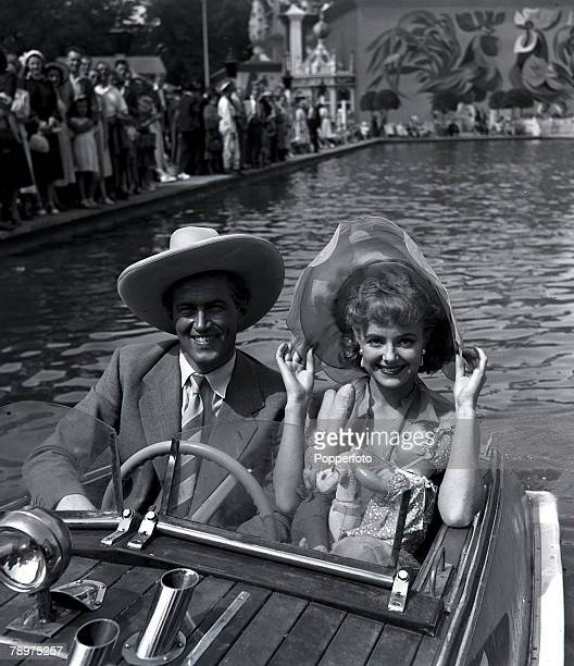 1951 Film stars John McCallum and Pauline Stroud in a publicity stunt at Batttersea funfair while filming 'Lady Godiva rides again'
