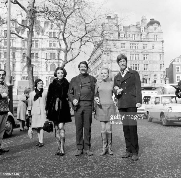Film stars on a break during rehearsals for a Royal Film Performance of Franco Zeffirelli's film of Romeo and Juliet, on the left is Joan Collins and...
