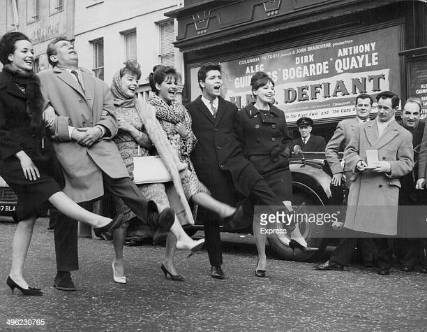 Film stars Sylvia Sims, Peter Finch, Janet Munro, Claudia Cardinale, Cliff Richard and Leslie Caron, lined up outside Odeon Cinema, Leicester Square,...