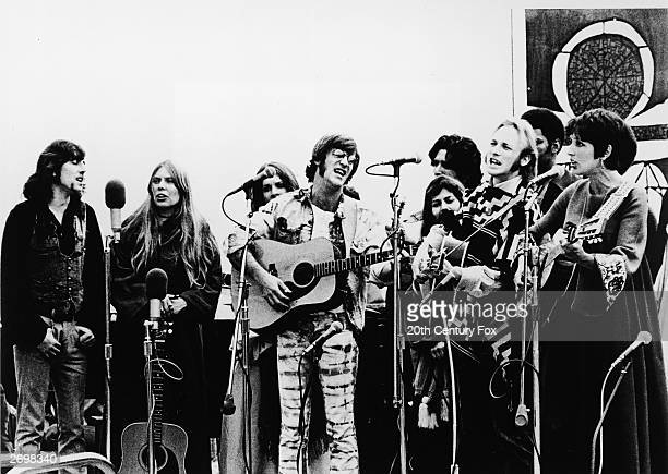 A film still from the documentary 'Celebration at Big Sur' with singers and musicians Graham Nash Joni Mitchell John Sebastian Steve Stills and Joan...