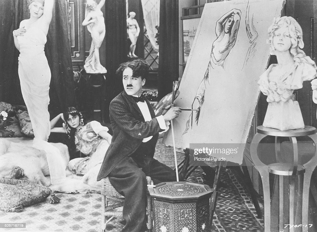 Film Still Of Actor Charlie Chaplin Painting A Portrait In A Scene From The  Film U0027