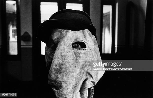Film still of actor John Hurt wearing a cloth sack over his head in a scene from the film 'The Elephant Man' 1980