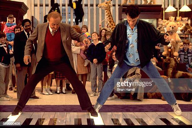 Film still shows American actors Robert Loggia and Tom Hanks on a giant keyboard at the FAO Schwartz toy store in the film 'Big' 1988