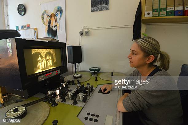 Film technician Lucie Budska watches the silent twominute film 'Match de prestidigitation' by the French early cinema pioneer Georges Melies on...