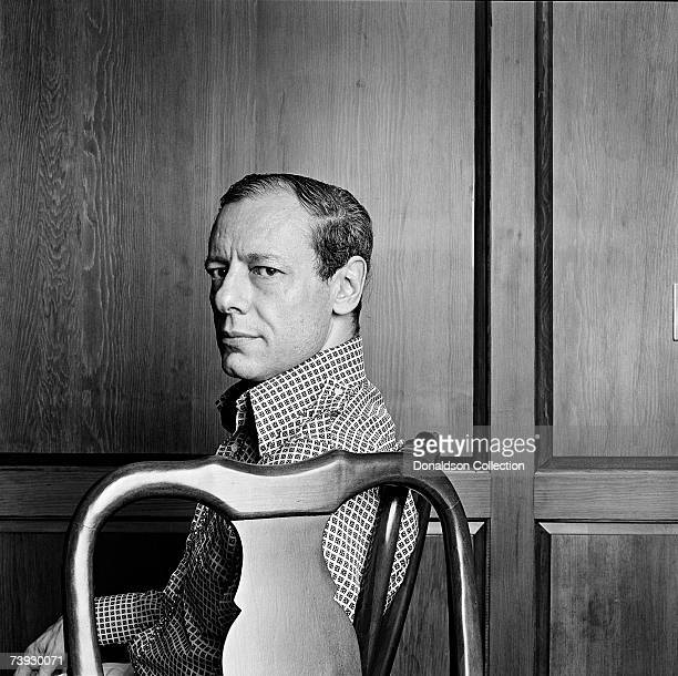 Film & Theatre critic John Simon poses for a photo shoot held in 1975 at the offices of New York Magazine, in New York.