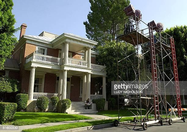 A film worker sits on the steps of a movie set inside Warner Bros Studio in Burbank Los Angeles CA 17 April 2001 Talks proceeded between the Writers...