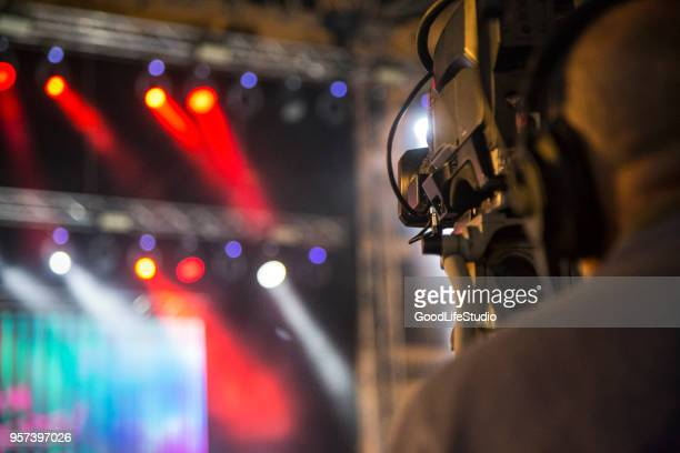 filming a live event - film crew stock photos and pictures