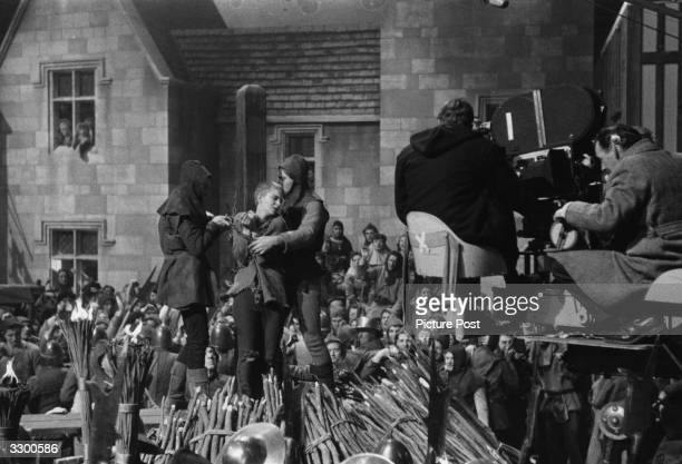 Filming a scene in 'St Joan' as the heroine is about to be burned at the stake The film is directed by Otto Preminger and adpated by Graham Greene...