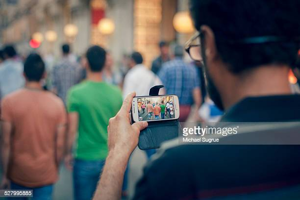 Filming friends with phone, Turkey.