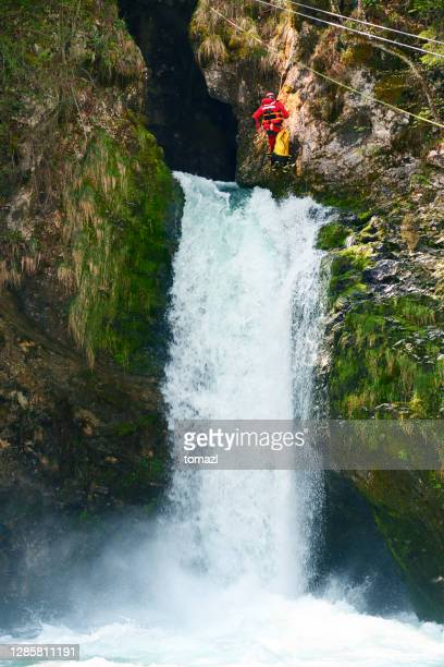 filming kayaking over big waterfall - recreational pursuit stock pictures, royalty-free photos & images