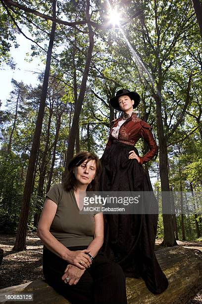 Filming of 'An old mistress' the masterpiece of Barbey d'Aurevilly adapted by Catherine BREILLAT the cinema the director sitting on a tree trunk...