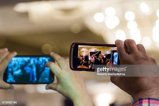 Filming video with smartphones at graduation ceremony The mobile or cell phone market continues to increase globally