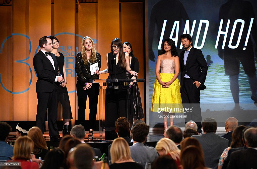 Filmmaker Aaron Katz, producer Sara Murphy, director Martha Stephens and filmmaker Christina Jennings accept the John Cassavetes Award for 'Land Ho!' from actors Jenny Slate and Diego Luna onstage during the 2015 Film Independent Spirit Awards at Santa Monica Beach on February 21, 2015 in Santa Monica, California.